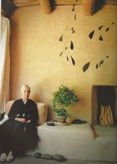 Georgia O'keefe at her home in New Mexico, with a Calder mobile