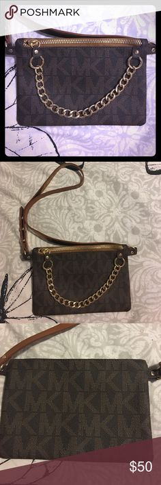Michael Kora Fanny bag. Brand new. Never used. Super cute fanny pack. All brown MK logo. With gold chain in from. Synthetic Leather. Ties with 3 buttons. MICHAEL Michael Kors Bags