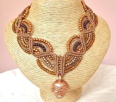 Waxed Linen Macrame Necklace with African Mask Pendant. $128.00, via Etsy.