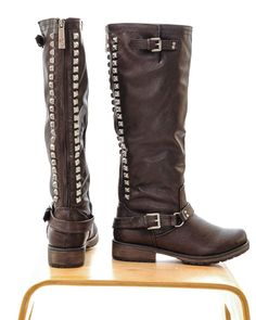 Studded vegan leather boots. Zipper up the back with antiqued brass studs. Accent buckles on the outside edges.