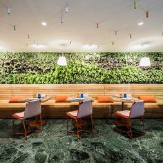 estudiHac's cheese bar for hotel melia features a vertical garden