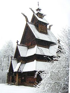 Norwegian old wooden church covered in snow, built during the 12th and 13th century.