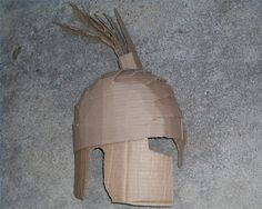 Spartan helmets were worn by the Spartan warriors to protect them from a foe& savage blows and to intimidate their enemies. You can make a cardboard replica of a Spartan helmet so your child can . Soldier Helmet, Soldier Costume, Warrior Helmet, Knights Helmet, Spartan Shield, Spartan Helmet, Spartan Warrior, Spartanischer Helm, Spartan Costume
