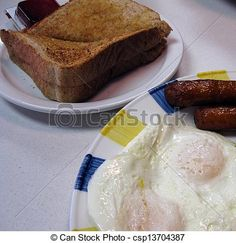 2 eggs over easy, sausages and whole wheat toast for breakfast at the diner.