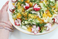 Summer salad, with shaved courgette, fennel, radishes, oranges and dill
