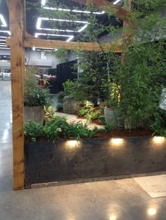 Lighting outside the booth on the steel planter draws attention to the garden.