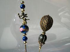 http://www.civilizedhumanbeing.com/wp-content/uploads/2012/06/antique-hat-pins.jpg