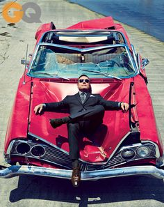 Bryan Cranston's GQ Shoot   Suit, $650 by DKNY. Shirt, $325 by Ralph Lauren Black Label. Tie, $60 by Calvin Klein. Pocket square by Paul Stuart. Sunglasses by Salt Optics. Socks by Falke. Shoes by Ermenegildo Zegna.