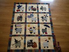Cotton quilt with wool sheep appliques