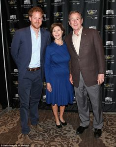 Bush (pictured with his wife Laura and Harry at the symposium on Sunday) said he wanted to...