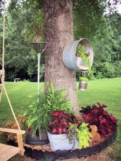 repurposed junk garden gardening repurposing upcycling I ran out of space in this tree circle so MWHP My Wonderful Hubby Phil had the idea to move the washtub up way up on the tree itself Garden Junk, Garden Planters, Lawn And Garden, Garden Art, Garden Hose Wreath, Hanging Planters, Hanging Baskets, Garden Tools, Garden Projects