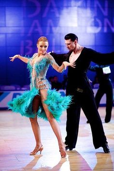 teal feathered latin dress #dancesport #dance #latindance