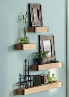 Styled shelves. Adds a fresh feel to the bedroom. Substitute bamboo on the small top left shelf for a more zen atmosphere. #HomeDecorators HomeDecorators.com