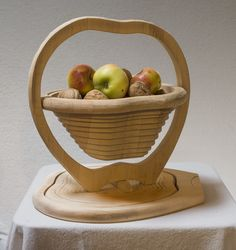 APPLE - shop.slo-list.com / The Kosmač workshop in Tržič has designed a special fruit bowl in the shape of an apple which is an interesting, practical and decorative item for every home.