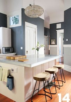 Two-tone kitchen with warm wood stools