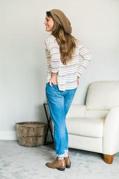 Fall fashion: Oversized knit tunic, distress boyfriend jeans, slouchy beanie and ankle boots // thinkelysian.com