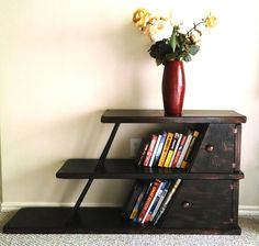 Leaning bookshelf. Unique modern vintage furniture. by SunofaBeachGallery on Etsy https://www.etsy.com/listing/188526865/leaning-bookshelf-unique-modern-vintage