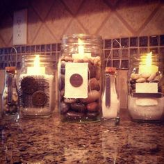 Candle holders. Mason jars, rocks, sand and extra charms!