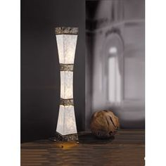 A gorgeous floor lamp that is eye catching and would add interest to and texture to any setting. The illumination shines gently through the mother of pearl shade for a soft, welcoming light. Segmented by antiqued decorative metal detailing, which matches the four feet.   This lamp is double insulated which ensures that it is safe to use in any home, including some older properties which may not have an earth cable.   This lamp would add a wow to any space, but we especially love it in living…