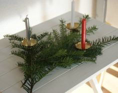Prepping for Christmas: Candle clips on an evergreen spray. What a cool idea! Visit us at www.christmasgiftsfromgermany.com