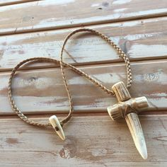 A personal favorite from my Etsy shop https://www.etsy.com/listing/566308559/axis-deer-antler-tip-cross-necklace