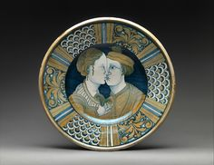 Dish with two lovers, ca. 1520–50, Italian, Deruta. Maiolica (tin-glazed earthenware), lustered. Overall (confirmed): 3 5/8 × 16 5/8 in. (9.2 × 42.2 cm). Purchase, 1884, 84.2.11 © 2000–2016 The Metropolitan Museum of Art.