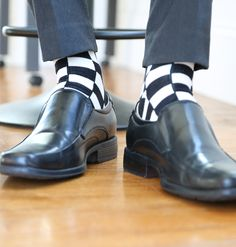 Statement Sockwear Checkered Black & White featuring the January Sock Colors of the Month. Every purchase of Statement Sockwear provides 100 days of clean water for someone in Africa. Make a statement. Make a difference.