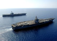 U.S. Navy Ships USS Dwight D. Eisenhower and USS Enterprise traveling side by side