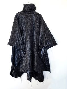 Raf Simons AW02 Poncho. This AW02 poncho is made of this incredible material that almost feels like a plastic bag. It's actually woven with different kinds of thread and has an amazing texture to it. Photography Lixx Diaz. David Casavant's Archive.