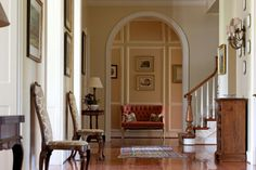 Love arched entry as well as the floor!  Oh and the space too.