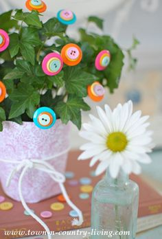 DIY button flowers are so easy to make and brighten your houseplants with color!