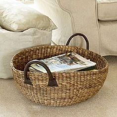*shallow round basket with leather handles (perfect size for magazines) from: theholdingcompany.co.uk