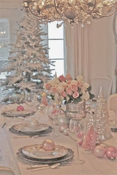 pink and silver Christmas decoration table setting, tree and chandelier