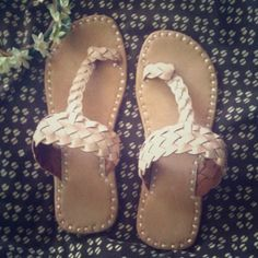 Bohemian handmade slippers Brand new , never worn . Handmade slippers from India , genuine leather , bohemian style . These do run small , these are a size 7 which means they will fit a 6 to 61/2 perfect . Not free people just used it for more views . Free People Shoes Sandals