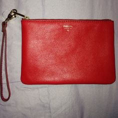 """Red Fossil Wristlet Brand new. Never used. In great condition!  Brand: AUTHENTIC Fossil 100% Real Leather  Reason why I'm selling it: I recently became vegetarian and wristlet is made out of leather. (Animal Lover❤️)  Measurements:  7"""" (Left to right) 5"""" (height)  Original price: 45.00 Will ship ASAP!  Fossil Bags Clutches & Wristlets"""