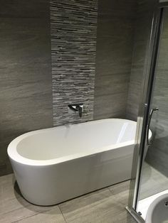The Arc freestanding bath looks beautiful against the grey tiles in this bathroom belonging to Jason in Newcastle Upon Tyne Eyebrow Makeup Tips Grey Bathroom Wall Tiles, Bathroom Tile Designs, Grey Tiles, Grey Bathrooms, Bathroom Layout, Beautiful Bathrooms, Bathroom Interior, Modern Bathroom, Bathroom Ideas