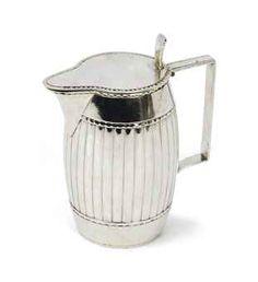A Dutch silver milk-jug  Mark of Henricus Hubert, Groningen, 1785/86  Ton-shaped, with rectangular ear, the interior gilt, marked on base  8 cm. high  136 gr.