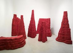 Rose Nestler Crimson Expanse from Lithic Habitats Installation 2012 hand-silkscreened fabric and hand-upholstered cushions dimensions variable