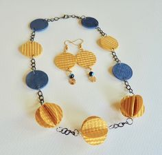 Gold and navy handmade necklace and earrings set by Maureen Mitchell.