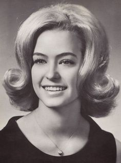 The 'Beehive', 'Pixie' and the 'Flip' were the main three hairstyles seen around the mid 60's.  This is Farrah Fawcett's senior high school picture.