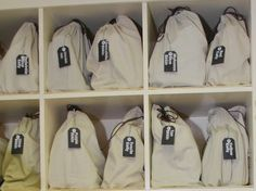 closet storage for purses | Purse storage using labeled dust bags