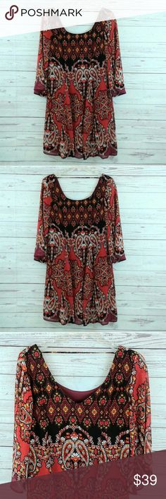 "Charlotte Russe Boho Dress. Small. Vivid colors with 3/4 sleeve & scoop neck. Sexy v-neck back.  Lightweight polyester  length 34""  Sleeve length 12: ecellent condition. Like new. No flaws. Charlotte Russe Dresses"