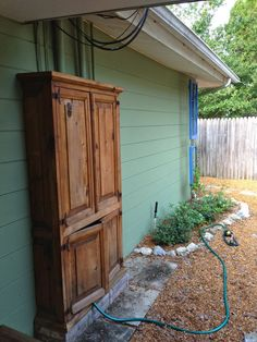 After our backyard shed makeover was complete, I needed to cover up this unsightly rats nest of wires and cables, the cable box, the water f...