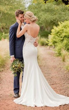 D2396 Sleek Lace Wedding Gown by Essense of Australia (I love the thin straps, the way it hugs her curves, and the flare is okay)