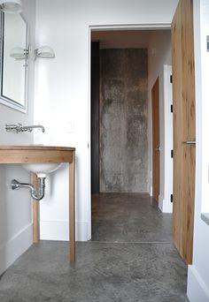 concrete floor in bathroom in barn designed by Briggs Edward Solomon (via A Thoughtful Eye)