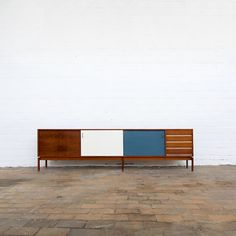 Jos de Mey; Rosewood, Brass and Lacquered Wood  'Abstracta' Credenza for Van Den Berghe-Pauvers, 1950s.