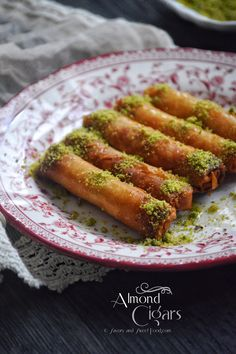Crunchy phyllo pastry stuffed with an orange blossom water fragranced almond filling which is then drenched in sugar syrup. This sweet dish reminds me so much of the Moroccan biscuits…