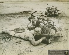 """""""Soldiers use their motorcycles as shields in a training exercise at Camp Carson, CO, 1943."""""""