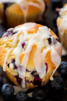 These lemon blueberry muffins are bursting with fresh blueberry flavor. This blueberry muffin recipe has a soft and moist crumb and they puff up perfectly. The easy lemon glaze recipe makes them completely irresistible and they always disappear fast! | natashaskitchen.com