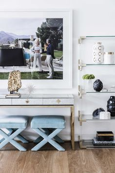 Gorgeous shelf styling with large artwork and X benches - lucite and brass shelf - Slim Aaron artwork - Kaufman Desert House III